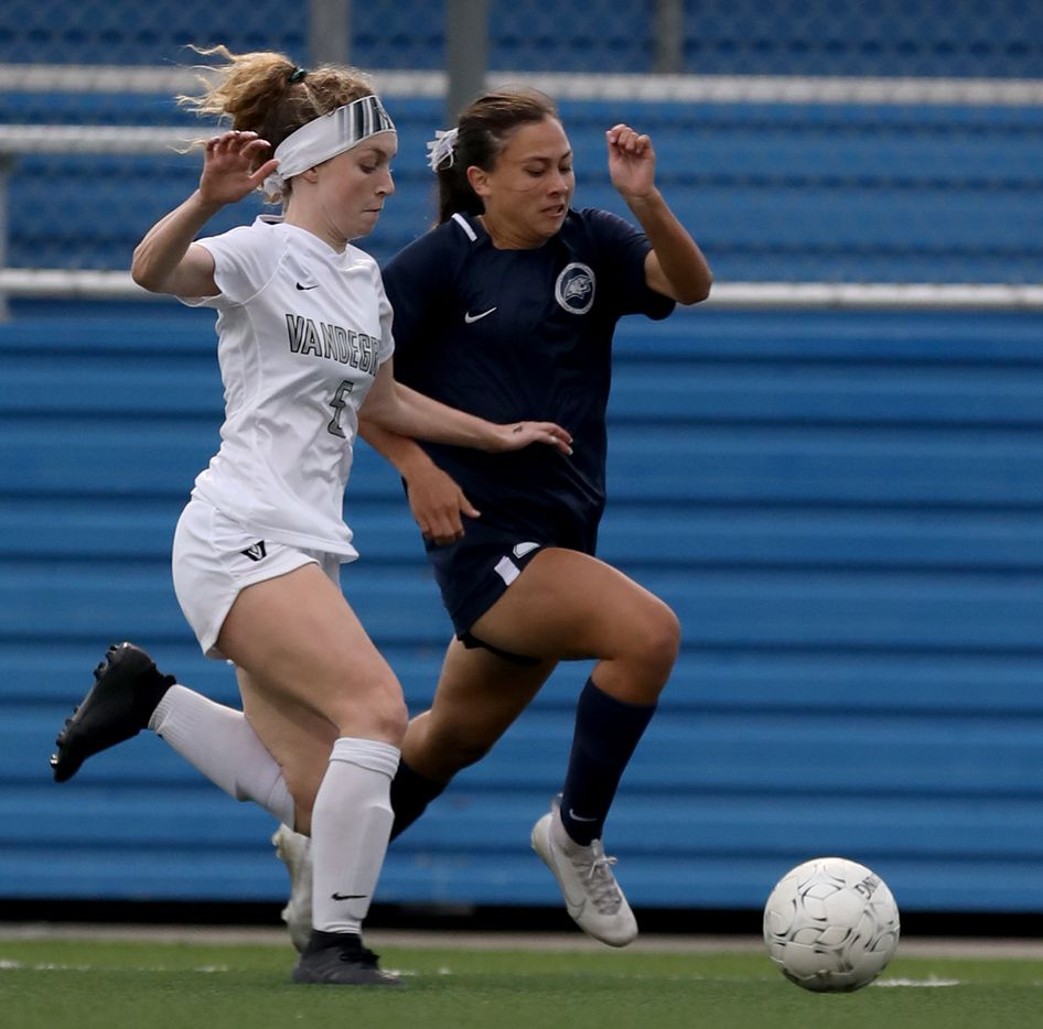 Austin Vandegrift's Addie Carriere (5) and Lewisville Flower Mound's Emma Hoang (23) chase after the ball during their UIL 6A girls State championship soccer game at Birkelbach Field on April 16, 2021 in Georgetown, Texas. (Thao Nguyen/Special Contributor)