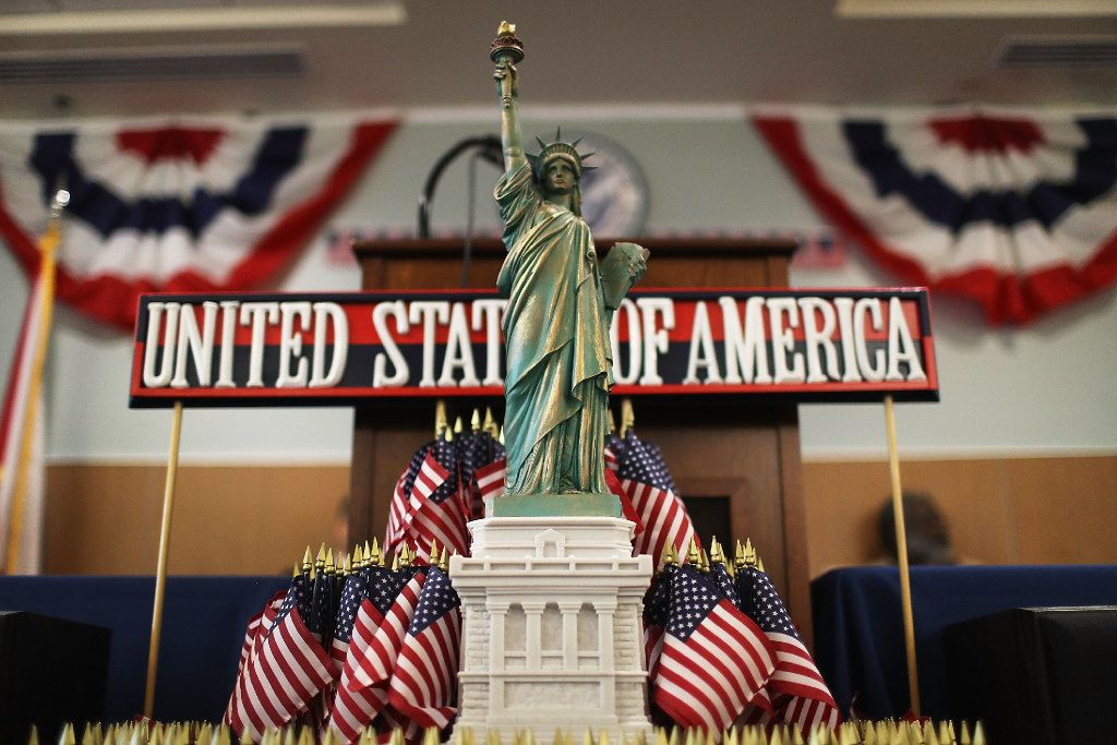 A model of the Statue of Liberty adorns a podium at a naturalization ceremony. (Joe Raedle/Getty Images)