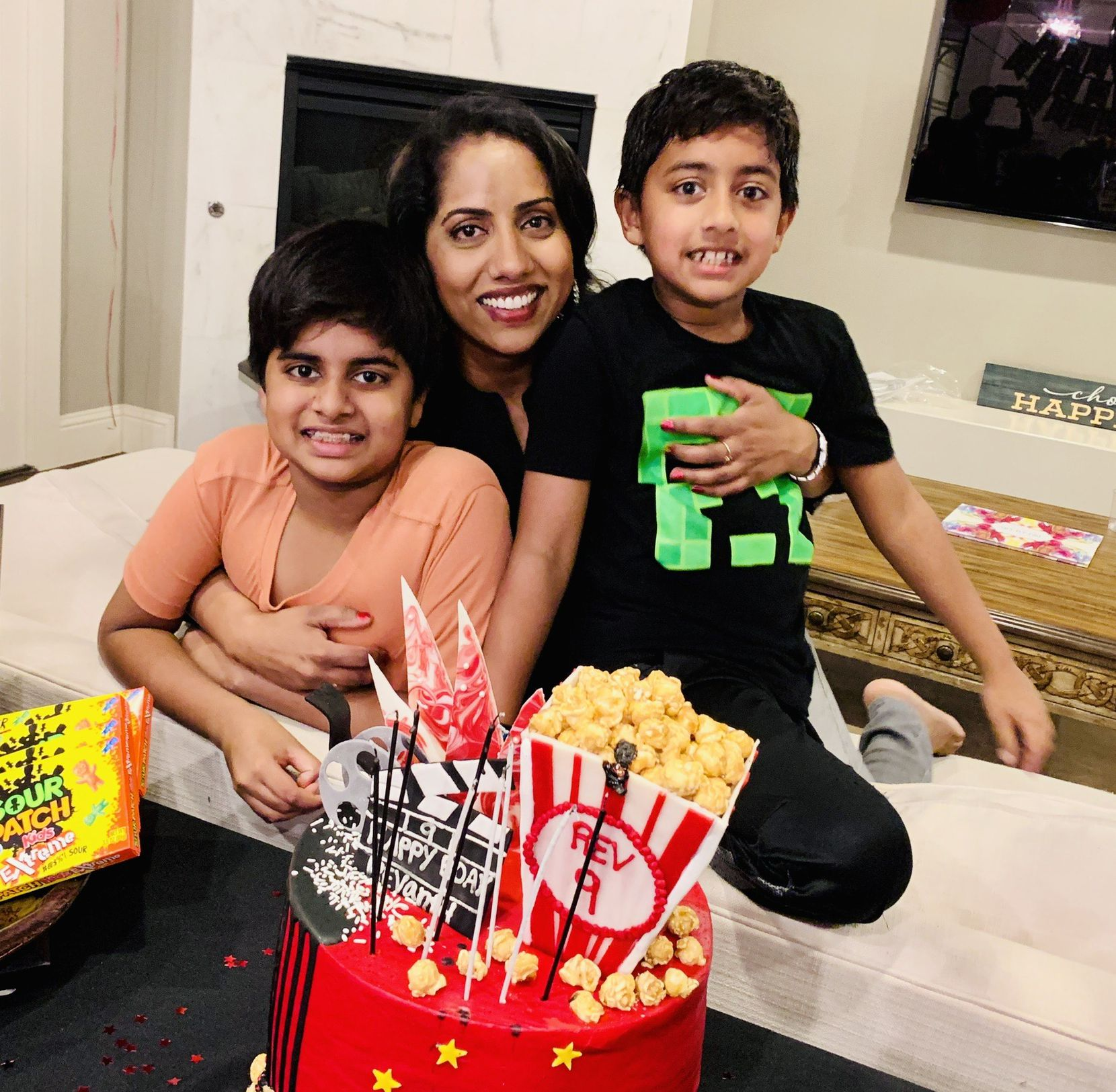 Dr. Prasanthi Ganesa, a Fort Worth oncologist, agreed to donate her bone marrow to a boy who was her youngest son's age. Here she poses at her home in Colleyville, with Raghav, 12, left, and Revanth, 7, right.