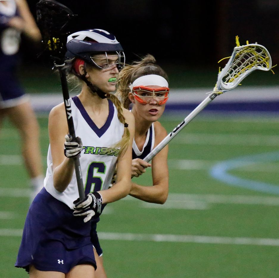 Frisco's Haley Donovan (6) looks to make a pass while Higland Park's P.J. Van den Branden (19) defends during the first half as Highland Park played the Frisco Fury as part of the Patriot Cup lacrosse tournament at The Ford Center at The Star in Frisco on Saturday, February 18, 2017. (Stewart F. House/Special Contributor)