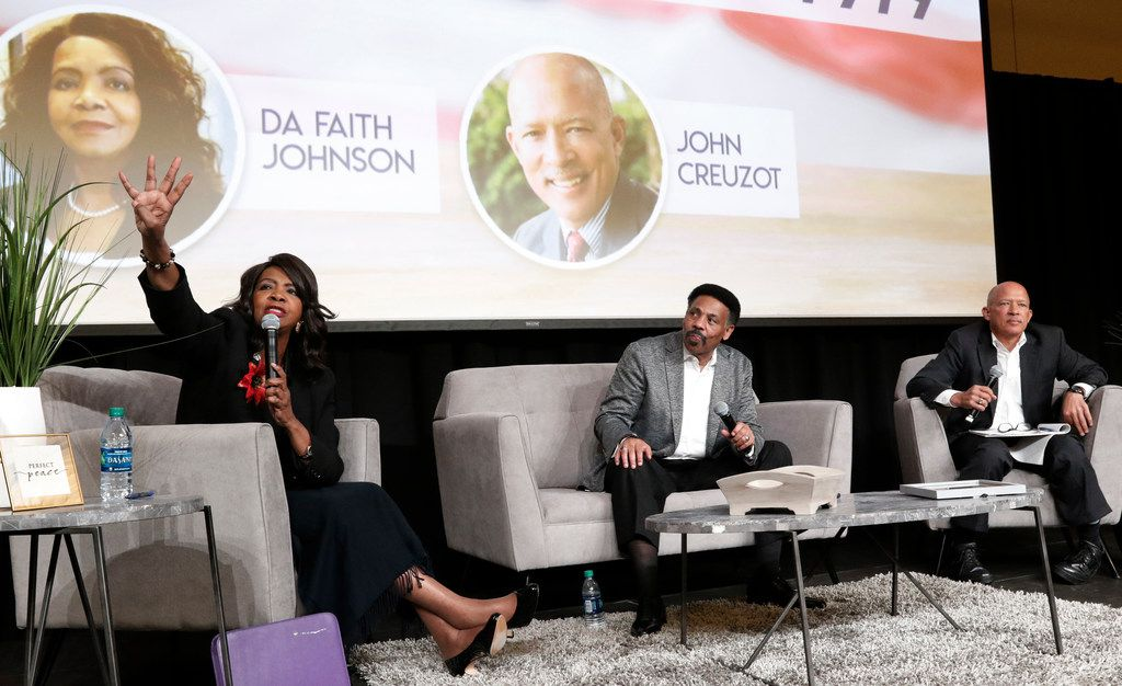 Dr. Tony Evans, center, Sr. Pastor of Oak Cliff Bible Fellowship church, and Ret. Judge John Creuzot, right, listen as Dallas County District Attorney Faith Johnson talks during an evening about life, faith and politics on Tuesday evening, Oct. 23, 2018, at OCBF church in Dallas.