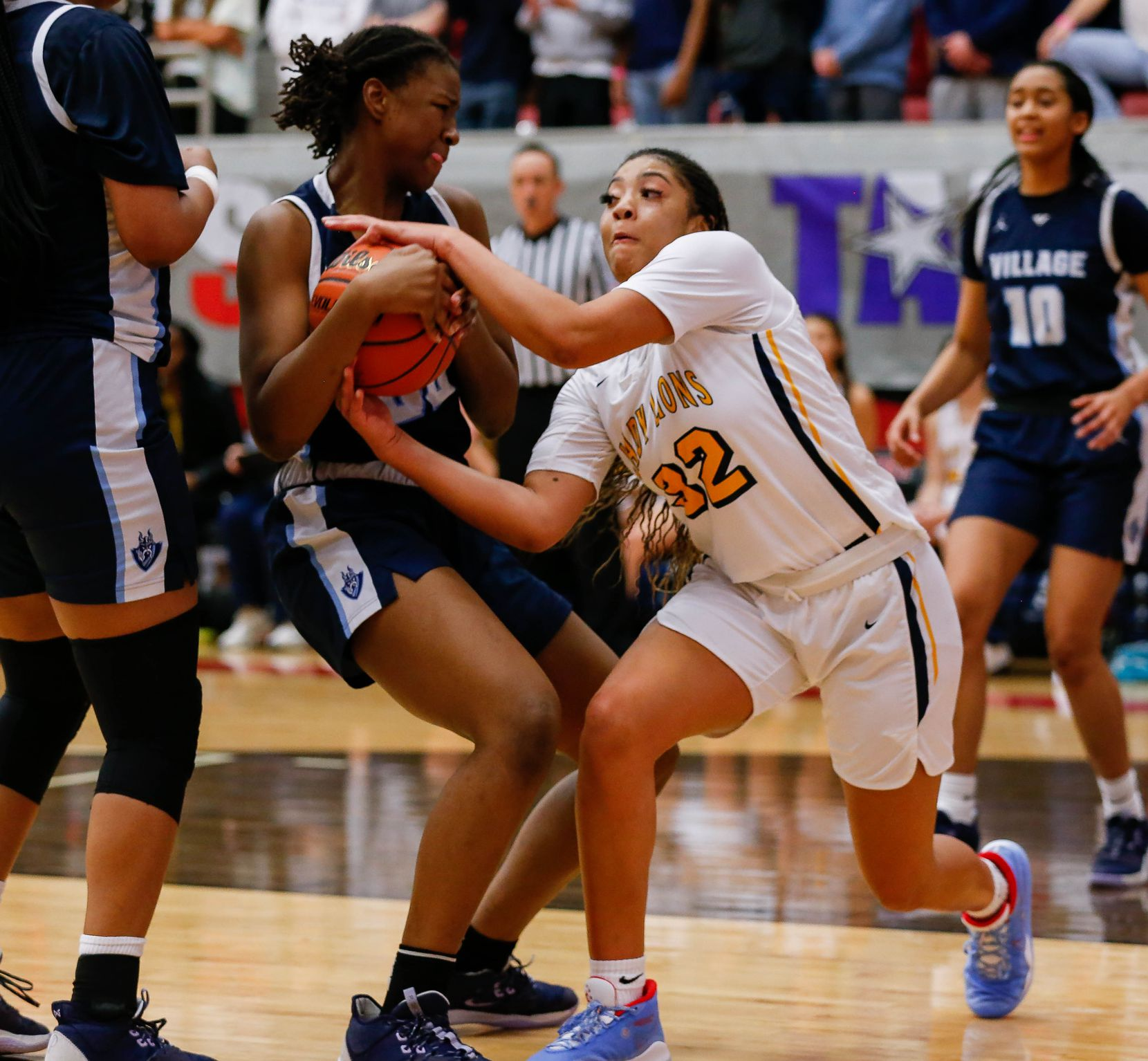 Plano Prestonwood Christian's Jordan Webster (32) fights the Village School's RyLee Grays (00) for the ball during the second half of a TAPPS Class 6A girls basketball state championship game on Feb. 28, 2020 in West. Prestonwood lost 75-48.