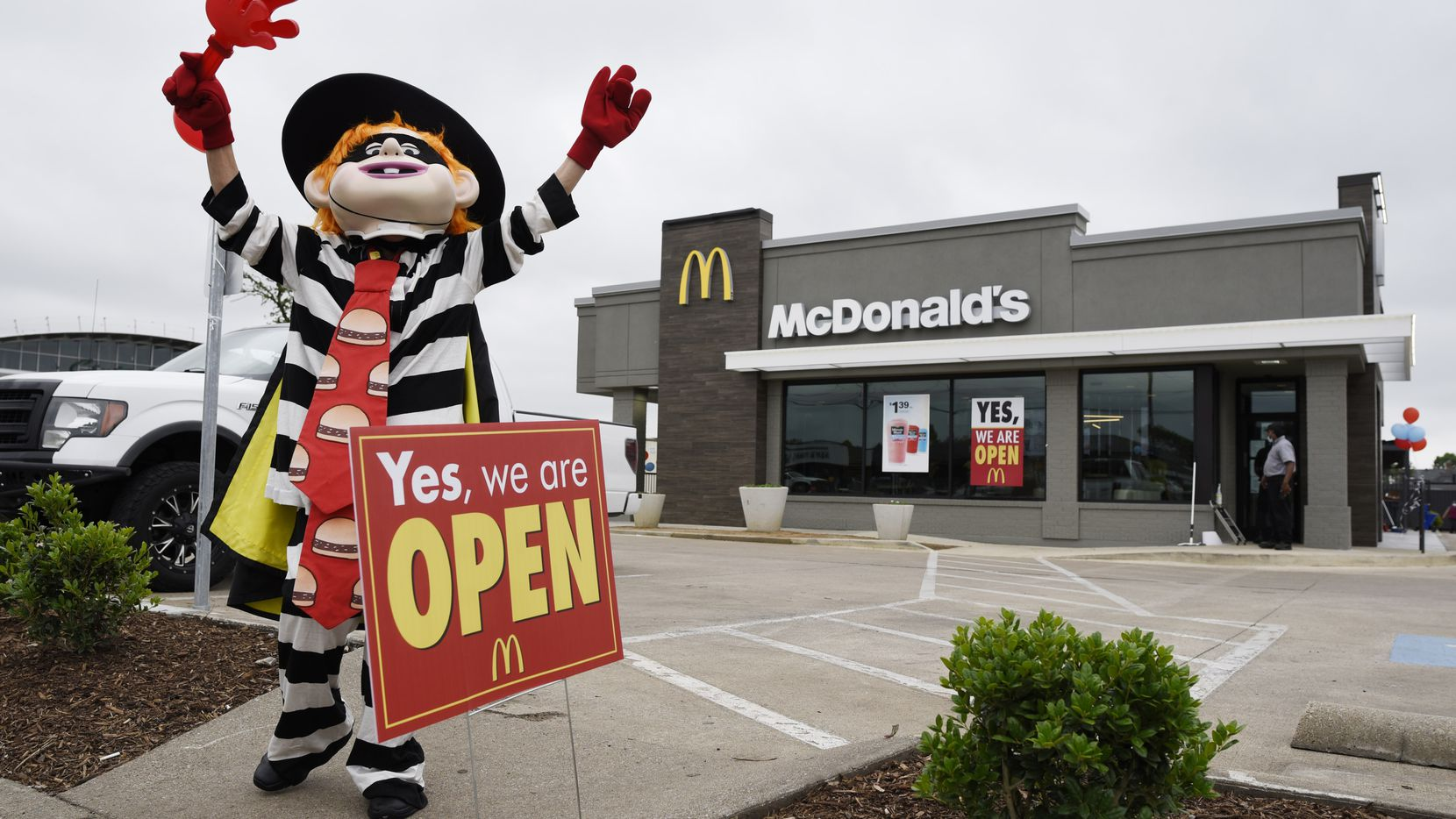 """A McDonald's employee is dressed as the """"Hamburglar"""" advertising the opening of the McDonald's restaurant at the Preston Oaks shopping center in Dallas, May 13, 2020. The McDonald's is opened for the first time since the October 2019 tornado that destroyed it. Ben Torres/Special Contributor"""