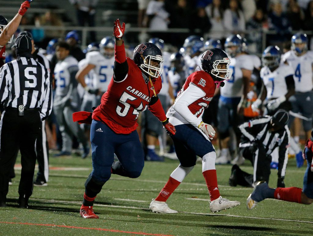 John Paul II defensive lineman Dylan Harris (54) celebrates after Nolan turned the ball over after failing on a 4th down attempt during the first half of their TAPPS Division I second-round high school football playoff game in Grapevine, Tx, Friday, Nov. 22, 2019. (Michael Ainsworth)
