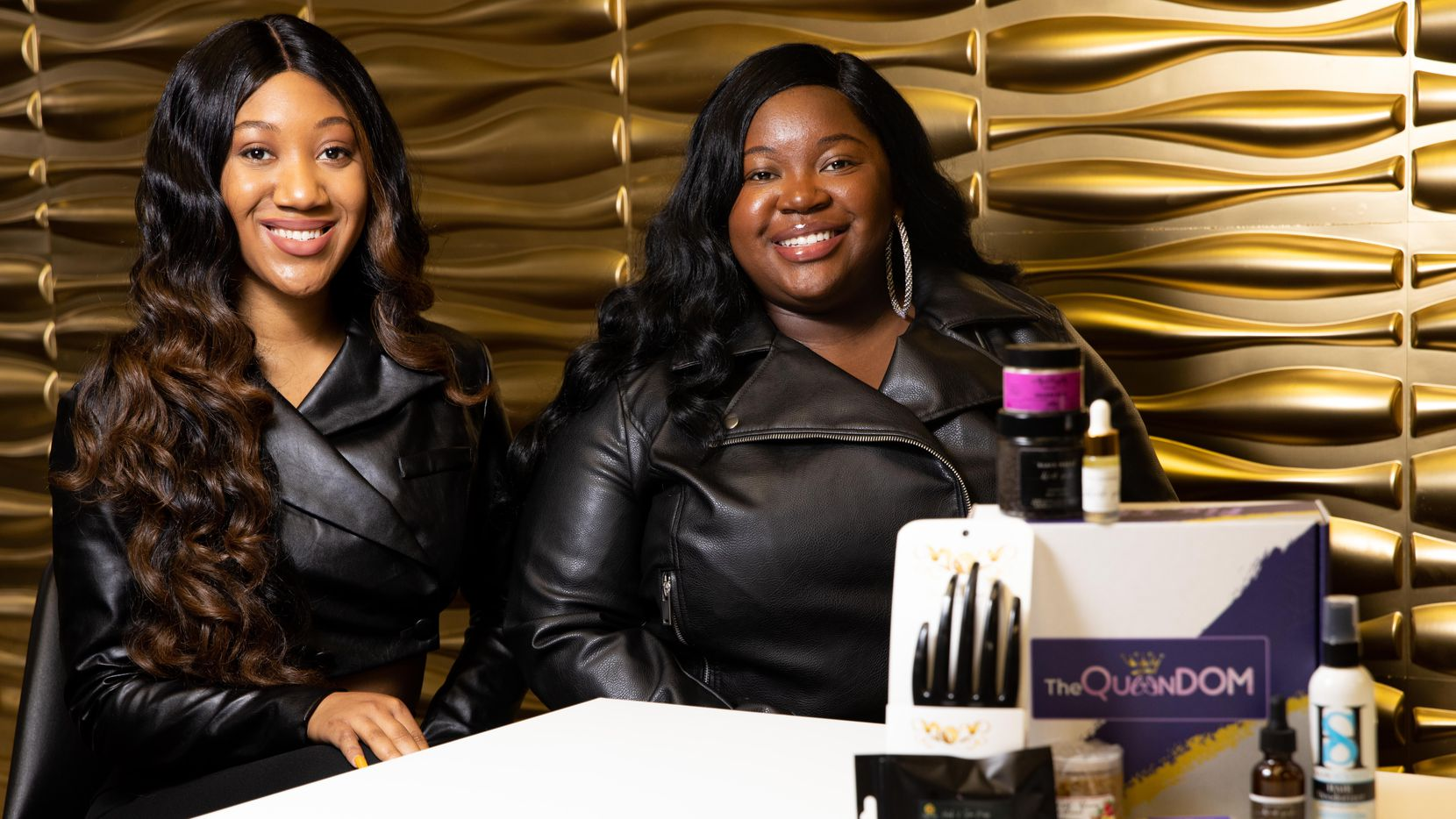 Bridgette Jones (left)  and Valese Jones pose for a photo with one of their subscriptions boxes in May. Dubbed the Queendom Beauty Box, each package contains new products from small businesses owned by women of color.