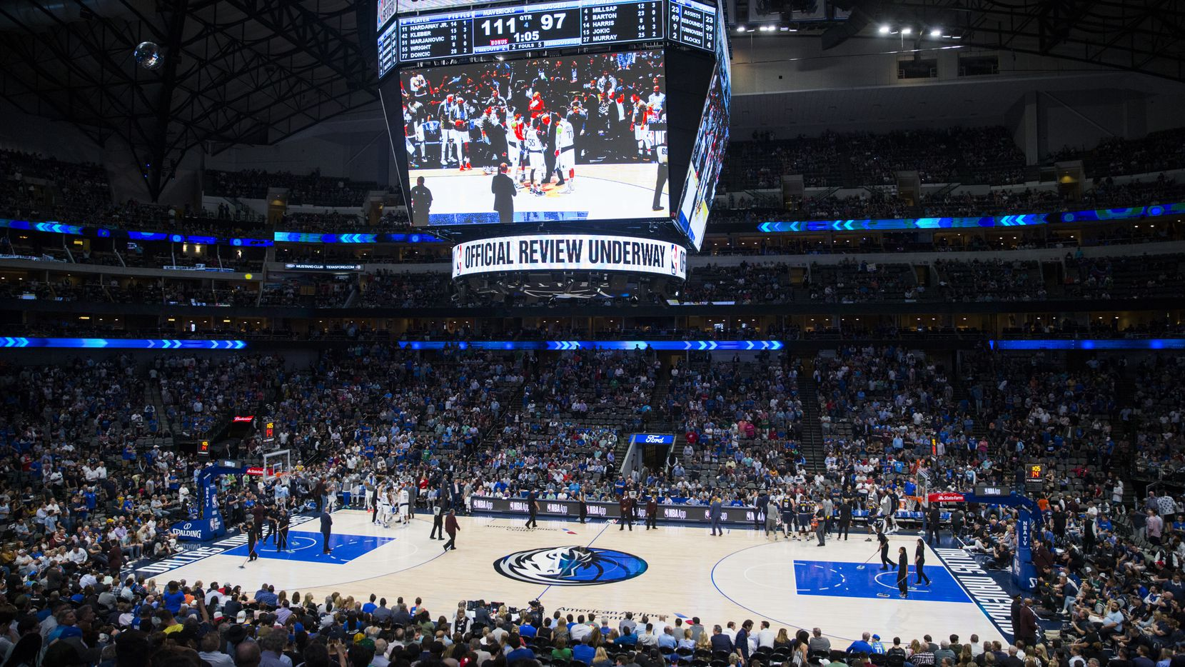 A mostly full arena in the fourth quarter of an NBA game between the Dallas Mavericks and the Denver Nuggets on Wednesday, March 11, 2020 at American Airlines Center in Dallas. During the game, the NBA suspended all games due to the spread of the new coronavirus. (Ashley Landis/The Dallas Morning News)