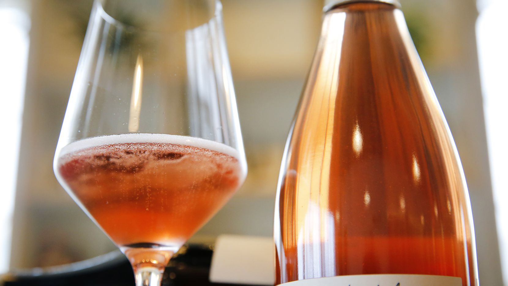 A glass of Les Capriades piege a filles rose rose is pictured at Bar and Garden on Ross Ave in Dallas, Tuesday, February 28, 2017.
