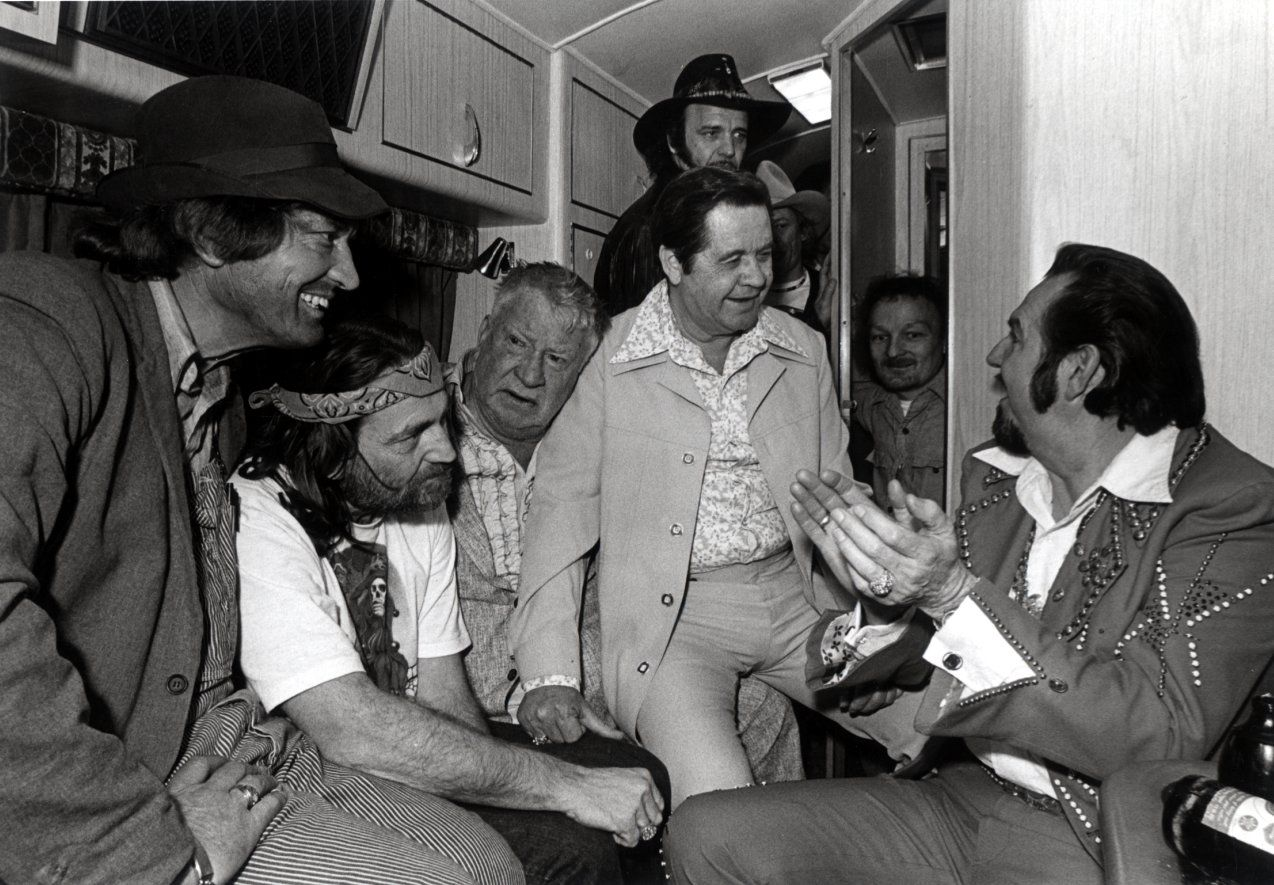 From left to right: Boxcar Willie, Willie Nelson, actor Chill Wills, Longhorn Ballroom owner Dewey Groom, Nelson's drummer Paul English (behind Mr. Groom), Ralph Franzetti (peering out of the bathroom) and Hank Thompson in Willie Nelson's Winnebago in the 1970s.