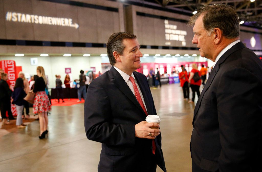 Texas Senator Ted Cruz (left) visits with Dallas mayor Mike Rawlings as he toured the 100K Opportunities Fair at the Kay Bailey Hutchison Convention Center in Dallas, Friday, May 19, 2017. (Tom Fox/The Dallas Morning News)