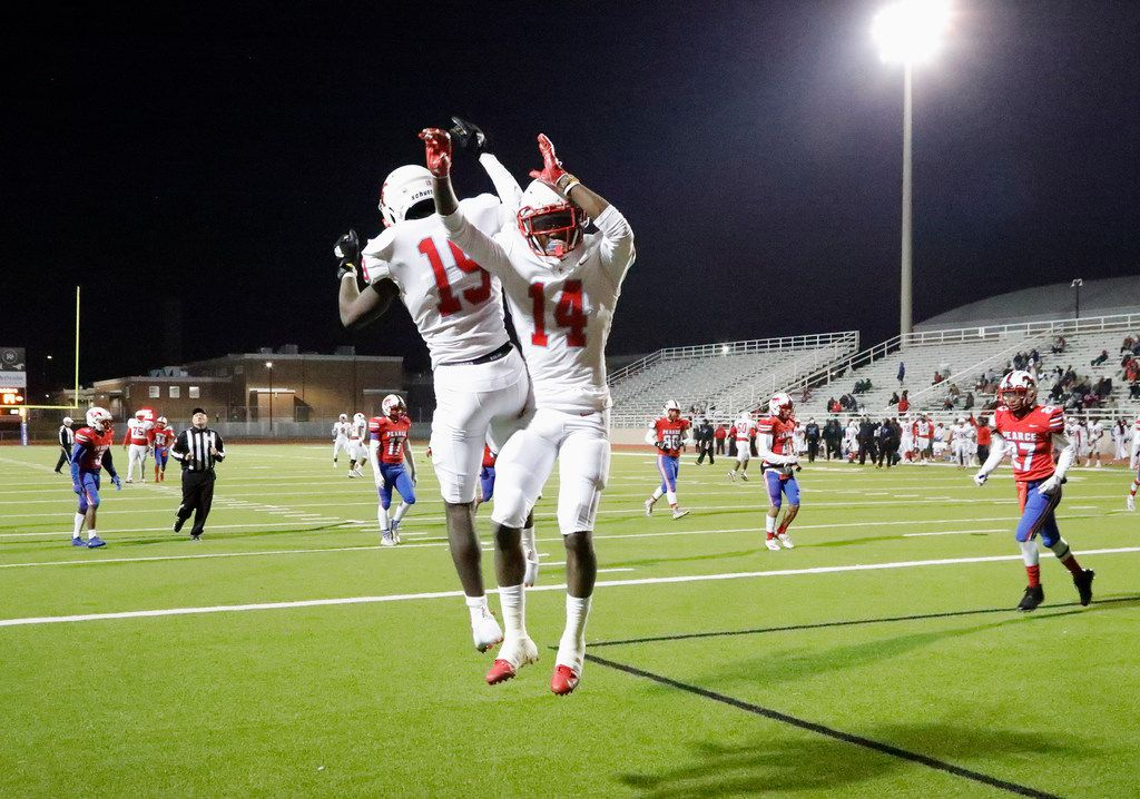 Skyline High School wide receiver Arabia Bradford Jr. (19)  celebrates with Skyline High School wide receiver Cameron Nelson (14) after Bradford scored a touchdown during the first half as J.J. Pearce High School hosted Skyline High School at Eagle/Mustang Stadium in Richardson on Friday night, November 8, 2019. (Stewart F. House/Special Contributor)