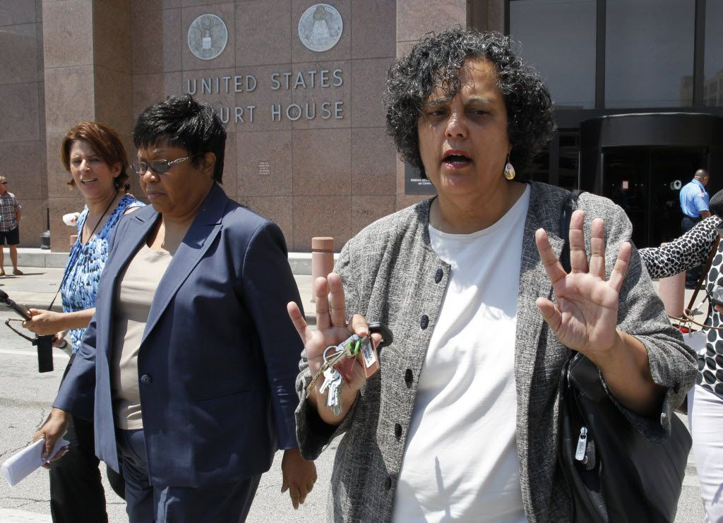 Kathy Nealy (left) leaves the federal courthouse in Dallas with her attorney, Cheryl Wattley, in July 2014 after being indicted in the Price corruption case (David Woo/The Dallas Morning News)