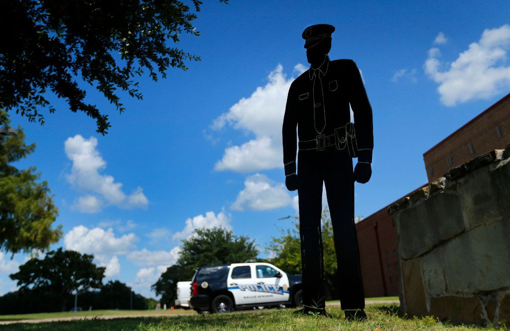 A wooden silhouette of a police officer stands in front of the Balch Springs Police and Fire Complex Monday in Balch Springs. Roy Oliver, the fired Balch Springs police officer who shot and killed 15-year-old Jordan Edwards, was indicted Monday on a murder charge by a Dallas County grand jury