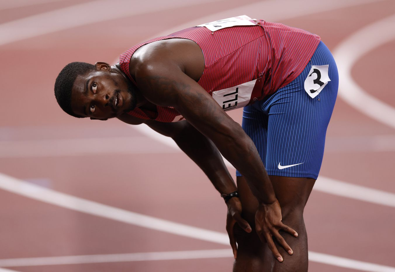 USA's Trayvon Bromell waits for the official time for his run in the men's 100 meter semifinal postponed 2020 Tokyo Olympics at Olympic Stadium, on Sunday, August 1, 2021, in Tokyo, Japan. Brommel finished with a time of 10.0 seconds and did not qualify for the final. (Vernon Bryant/The Dallas Morning News)