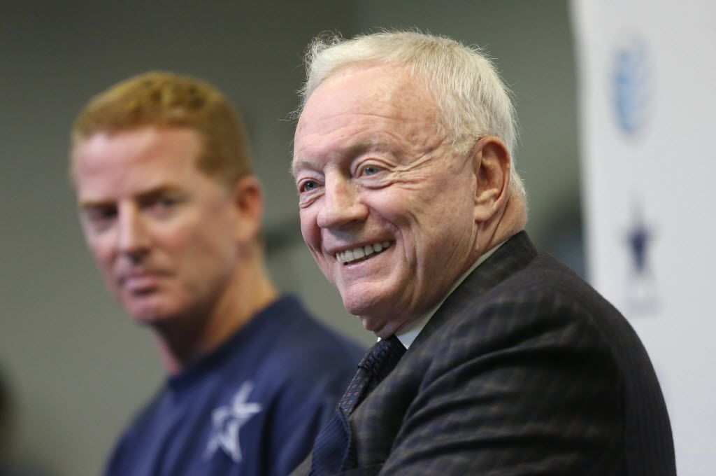 Dallas Cowboys owner Jerry Jones (right) shares a laugh with members of the media alongside head coach Jason Garrett after announcing a five-year contract for Garrett. The two discussed it at a press conference at Valley Ranch in Irving, Texas, Thursday, January 15, 2015. (Tom Fox/The Dallas Morning News)