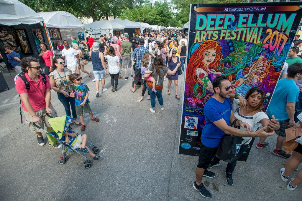 A couple takes a selfie at the Deep Ellum Arts Festival on Main Street in Dallas, Texas on April 8, 2017. (Robert W. Hart/Special Contributor)