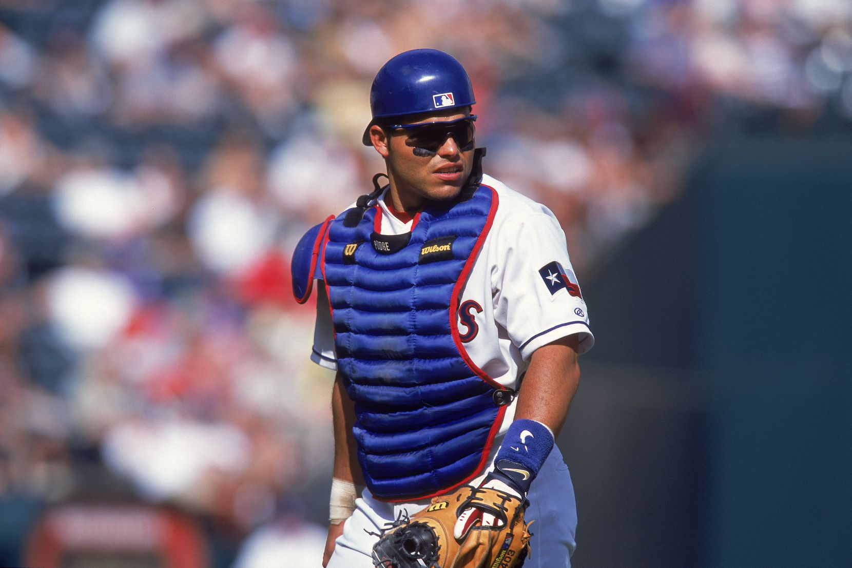 20 May 2001:  Ivan Rodriguez #7 of the Texas Rangers walks back to the plate during the game against the Toronto Blue Jays at The Ballpark in Arlington, Texas.  The Rangers defeated the Blue Jays 3-2.Mandatory Credit: Ronald Martinez  /Allsport