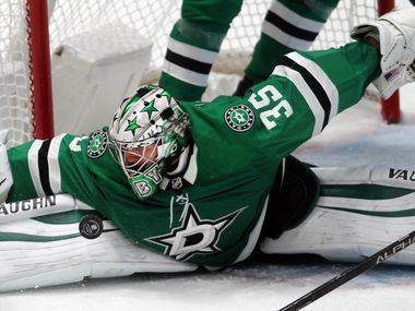 Dallas Stars goalie Anton Khudobin (35) gets a close look at the puck as he stretches out to block a shot by a Nashville Predators player during the final minute of play in the final period. The save helped to preserve a 3-2 Stars win. The two teams played their NHL game at the American Airlines Center in Dallas on January 24 , 2021. (Steve Hamm/ Special Contributor)