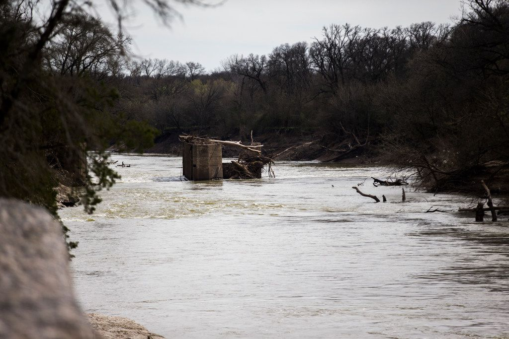 The remains of the old Trinity River Lock and Dam No. 1, constructed a century ago