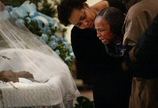 In April 2007, funeral services were held for Brandon Washington, who was shot and killed by Dallas police. His aunt, Cynthia Washington (right) was comforted before the service by Katrina Jo Randolph as she viewed Brandon's body.