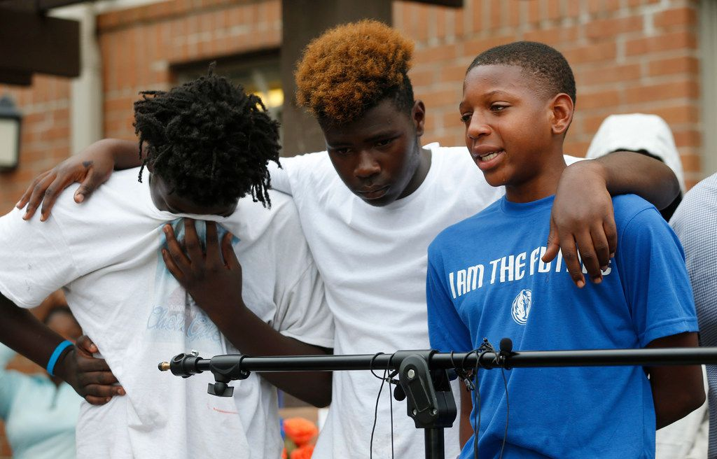 MaQuesta Martin Jr., right, gets emotional as he talks about his friend Malik Tyler during a vigil for him near the scene of the shooting in Dallas on Wednesday, June 5, 2019. Tyler was injured and killed in crossfire in the 9400 block of Bruton Road Tuesday night. (Vernon Bryant/The Dallas Morning News)