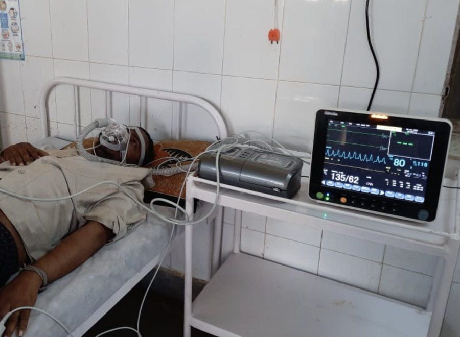 A COVID-19 patient uses a breathing device procured by the AIR Foundation. The foundation is made up of a dozen professionals linked by their Indian university ties. It has deployed $350,000 in resources to rural regions and is trying to raise an additional $450,000 by June 10.