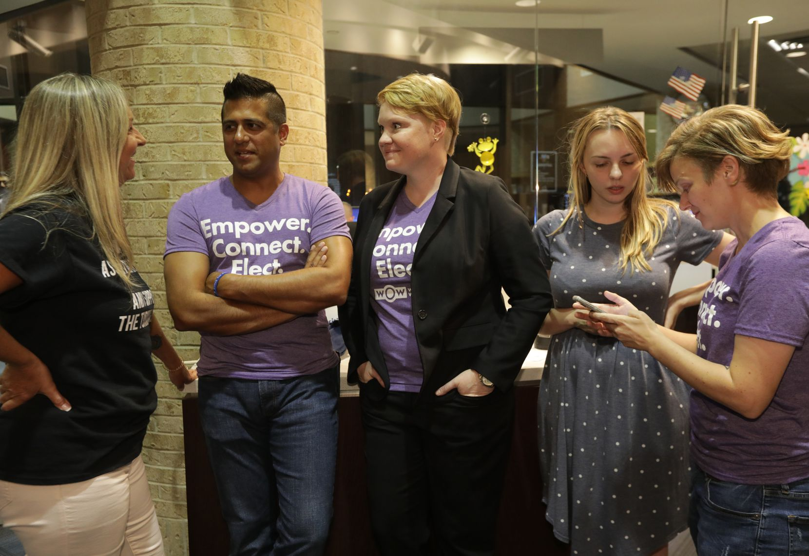Community members discuss the future of The Turning Point rape crisis center as they wait to speak in support of the center during a Plano city council meeting on Aug. 12, 2019.