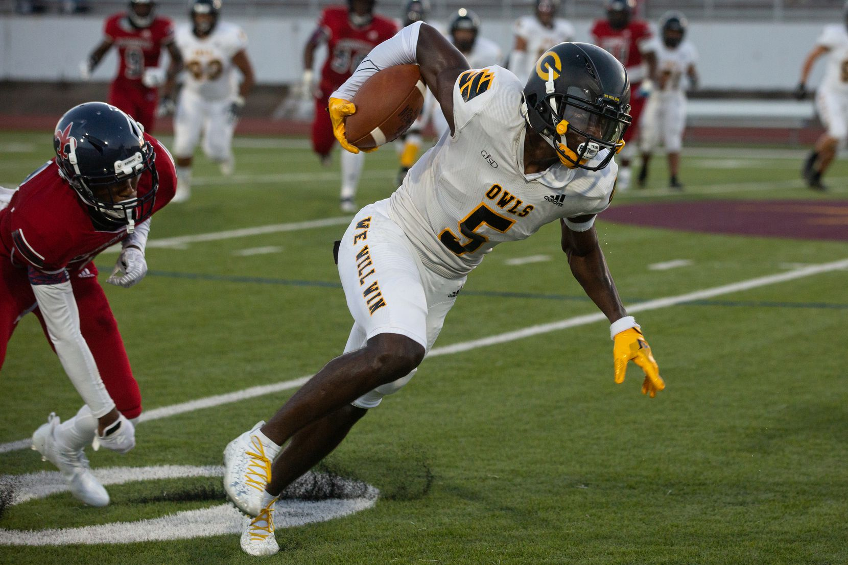 Garland High School wide receiver JordanHudson (5) powers through the defense during their season-opening game against Justin F. Kimball High School at Sprague Stadium in Dallas, TX on August 27, 2021.   (Shelby Tauber/Special Contributor)