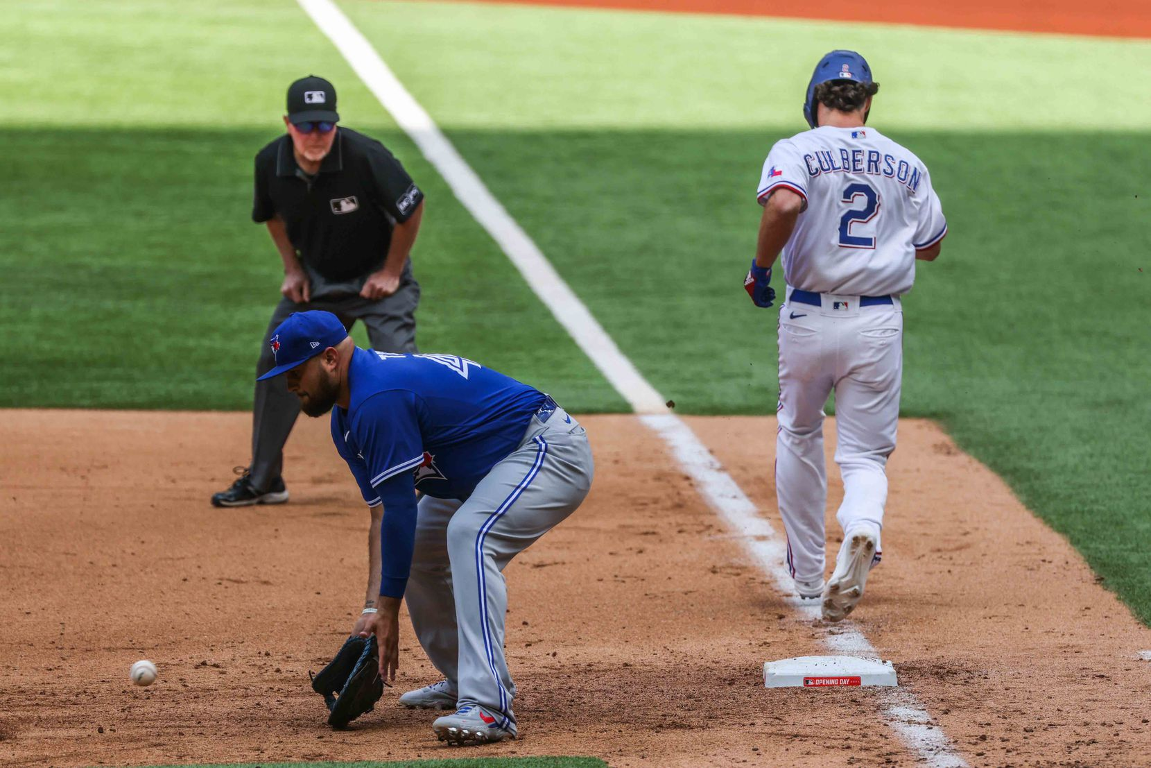 Texas Rangers' infielder Charlie Culberson No. 2 reaches first base safe during opening day against Toronto Blue Jays at the Globe Life Field in Arlington, Texas on Monday, April 5, 2021. (Lola Gomez/The Dallas Morning News)