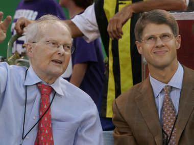 The late Lamar Hunt (left), shown at a Kansas City Chiefs game with his son Clark Hunt, is credited with naming the Super Bowl.