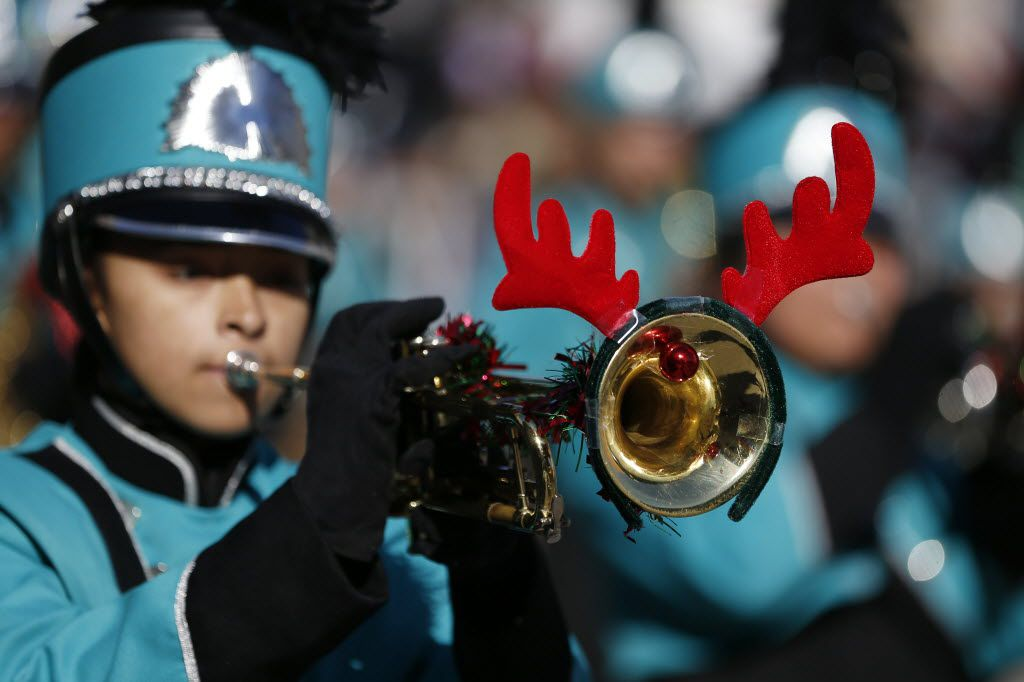 A Molina High School Jaguar Band trumpeter performs during the 28th annual Children's Health Holiday Parade through downtown Dallas Saturday December 5, 2015.