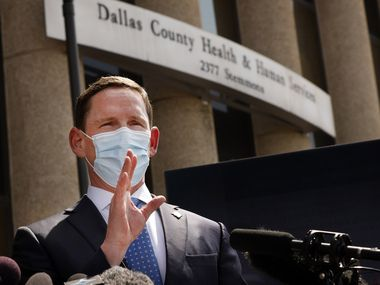 Dallas County Judge Clay Jenkins addresses the media about the current state of the coronavirus outside the Dallas County Health and Human Services building on Tuesday.