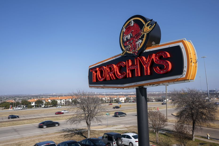 Cars pass by Torchy's Tacos on Interstate 635 in the Las Colinas/Irving area.