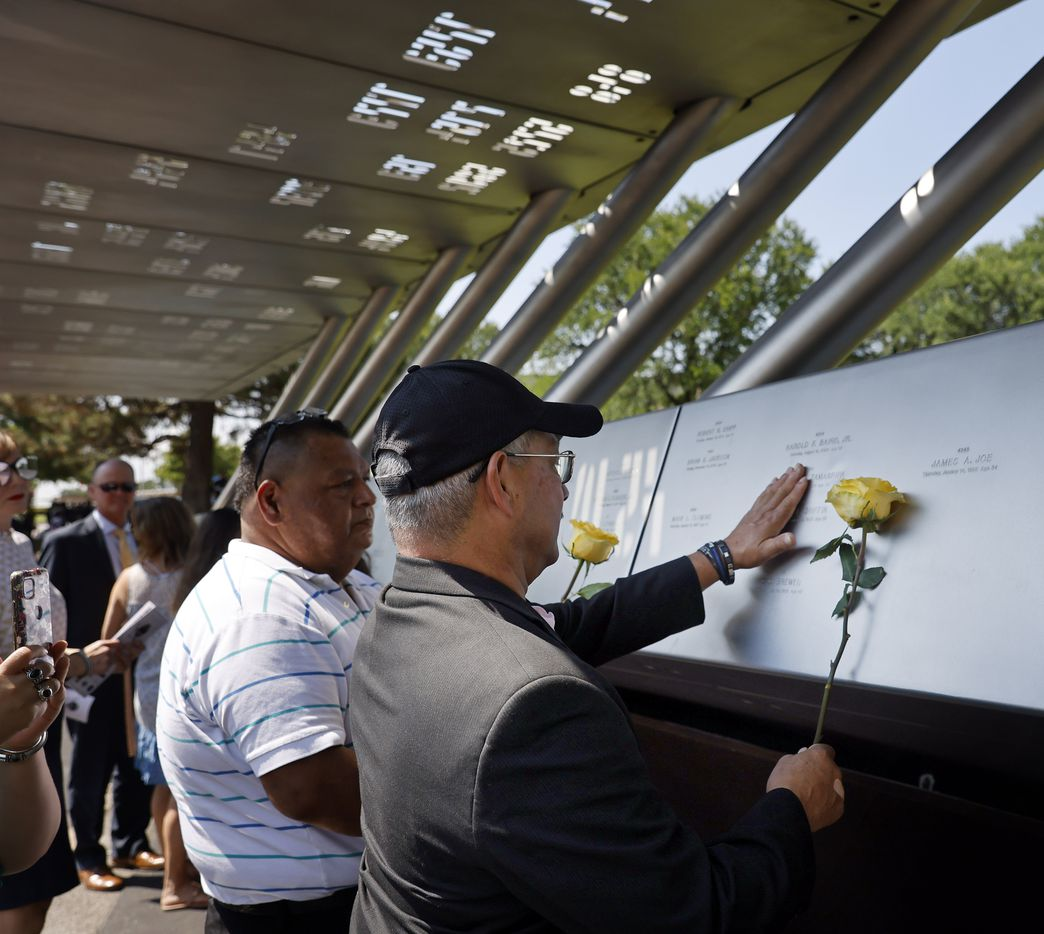 """Enrique Zamarripa, father of fallen Dallas officer Patricio """"Patrick"""" Zamarripa, lays a yellow rose in his honor following the annual Police Memorial Day in which the Department honored officers who died in the line of duty at the Dallas Police Memorial in downtown Dallas, Wednesday, July 7, 2021.  Zamarripa along with the other officers were remembered on the 5th anniversary of the July 7th ambush. (Tom Fox/The Dallas Morning News)"""