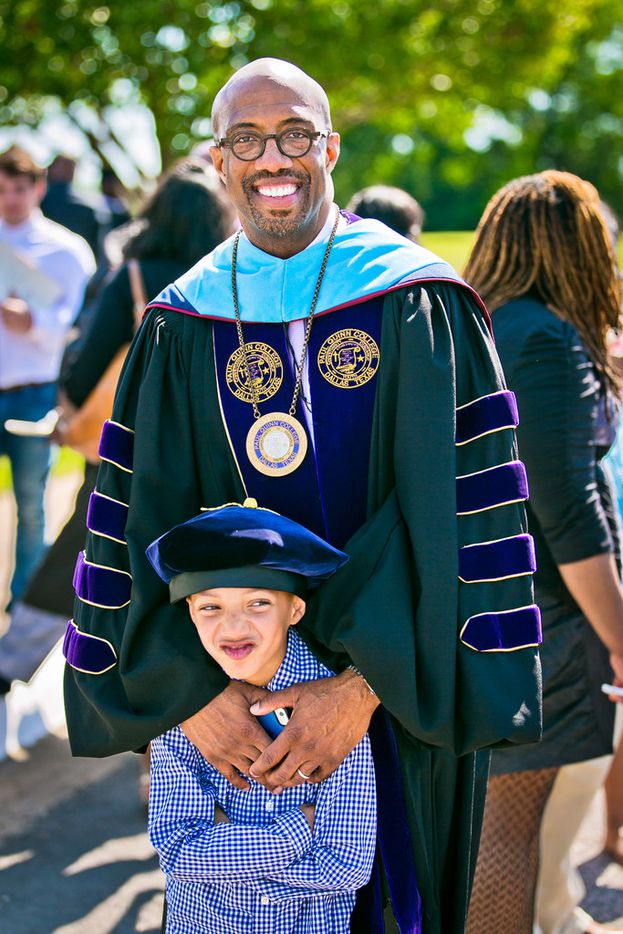 President Michael Sorrell with his son Michael at Paul Quinn College's commencement in 2016.Mica