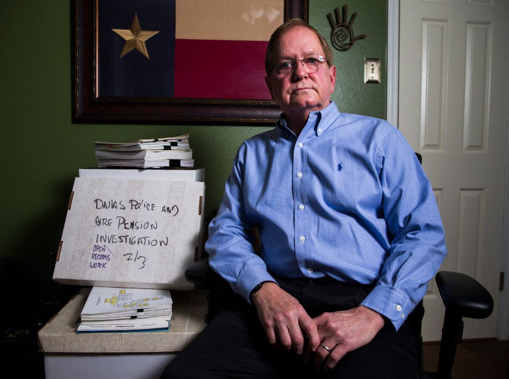 Forensic accountant Sandy Alexander poses for a portrait with boxes of files used in a lawsuit battle with the Dallas Police and Fire Pension System on Thursday, January 5, 2017 at his home in Dallas. (Ashley Landis/The Dallas Morning News)