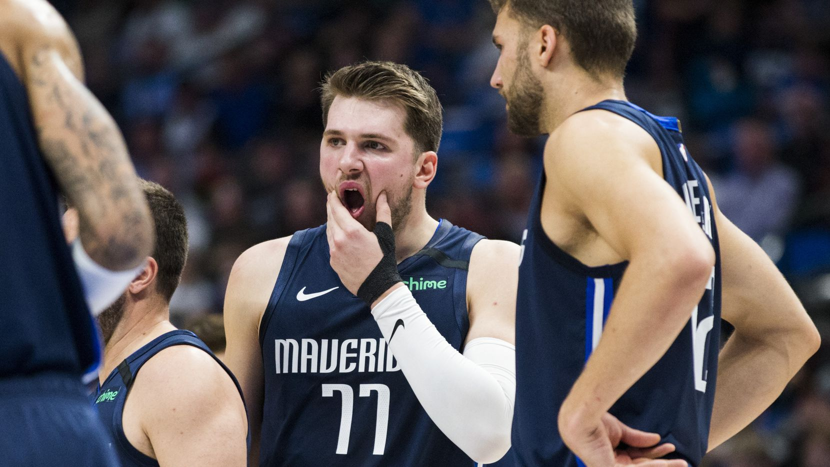 FILE - Mavericks guard Luka Doncic (77) reacts after being hit in the face by the knee of Pacers guard Edmond Sumner (5) during the second quarter of a game on Sunday, March 8, 2020, at American Airlines Center in Dallas.