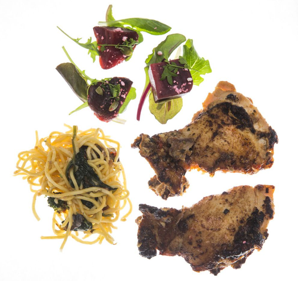 Sweet chili chicken served with micro greens and smoked beets with goat cheese, along with yakisoba noodles and stir fried vegetables prepared for Texas Rangers baseball players by the chefs at their spring training facility on Friday, February 24, 2017 in Surprise, Arizona. (Ashley Landis/The Dallas Morning News)