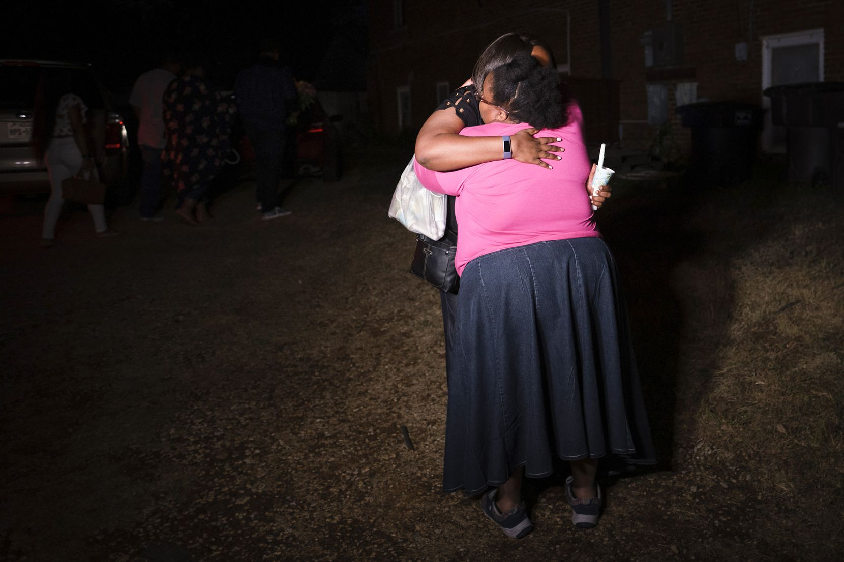 Members of the victimÕs family embrace as they depart a community vigil for Atatiana Jefferson on Sunday, Oct. 13, 2019, in Fort Worth.