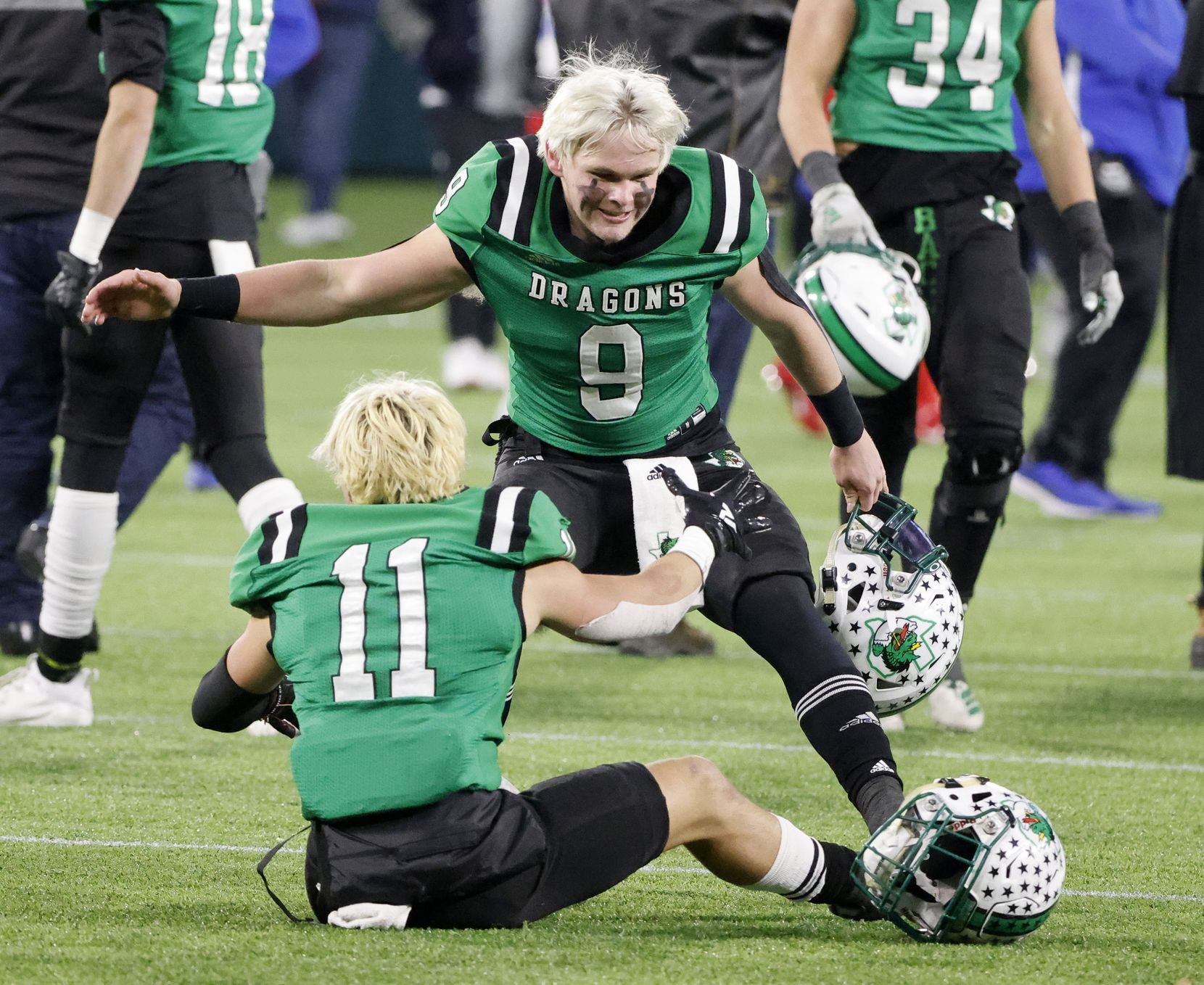 Southlake's Hunter Holden (9) and Josh Spaeth (11) celebrate their victory over Duncanville during the Class 6A Division I state high school football semifinal in Arlington, Texas on Jan. 9, 2020. (Michael Ainsworth)