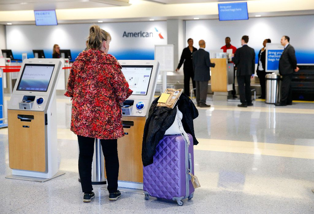 An American Airlines passenger used a kiosk to check in earlier this year at the newly renovated ticketing area of Terminal A.