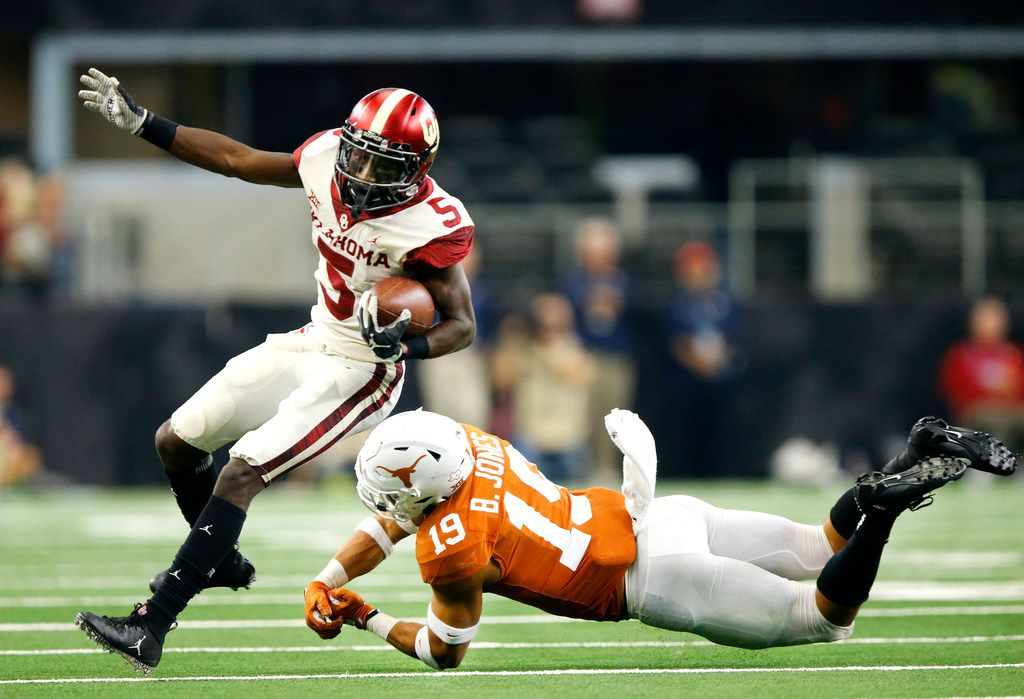 Texas Longhorns defensive back Brandon Jones (19) whiffs on a tackle attempt of Oklahoma Sooners wide receiver Marquise Brown (5) in the third quarter of the Big 12 Championship at AT&T Stadium in Arlington, Texas, Saturday, December 1, 2018. The Sooners defeated the Longhorns, 39-27. (Tom Fox/The Dallas Morning News)