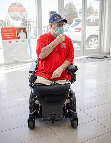 Retired U.S. Coast Guard Boatswain's Mate 2nd Class Gilbert Benoit of Plano, a Vietnam War veteran, reacts to seeing his new, specially-equipped van donated by Wells Fargo in collaboration with Courtesy Nissan of Richardson through the Military Warriors Support Foundation's Transportation4Heroes program.