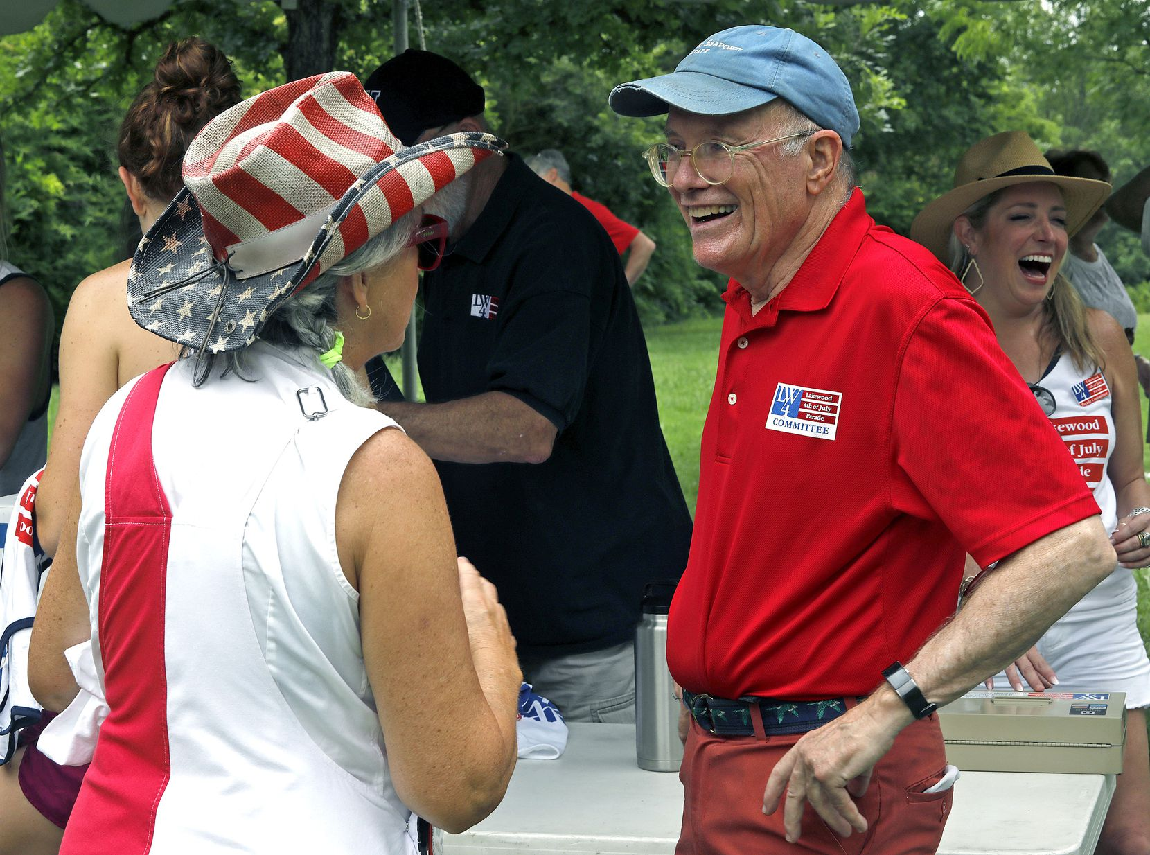 Millie Winston (left) and Al See, members of the Lakewood Parade Committee, talk after the event.