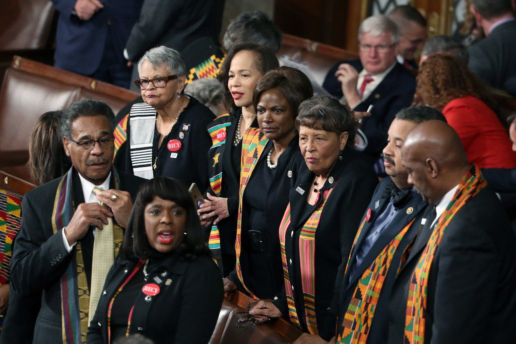 Members of Congressional Black Caucus wear black clothing and Kente cloth in protest ahead of a State of the Union address in the House chamber on Jan. 30.