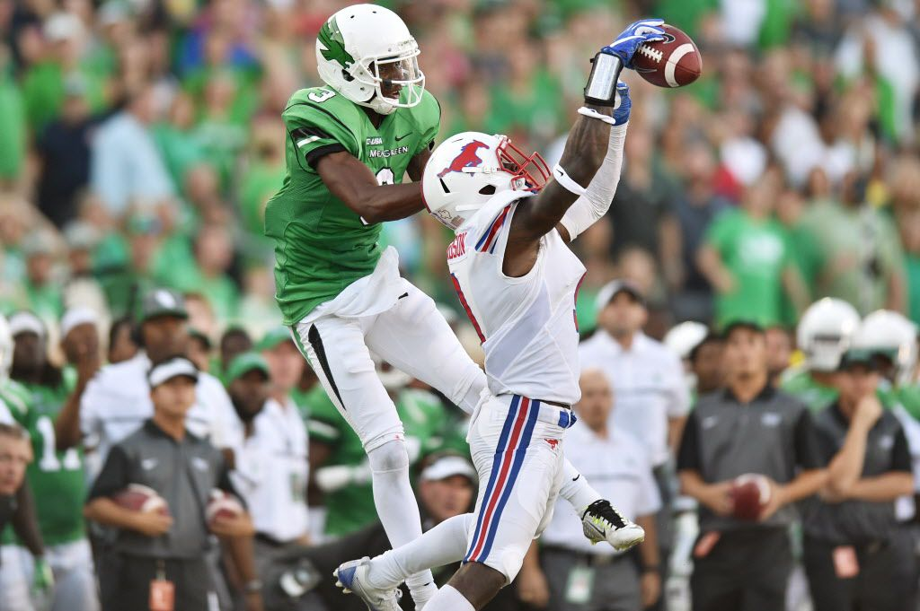 Southern Methodist senior defensive back Horace Richardson (9) intercepts a pass meant for North Texas sophomore wide receiver Terian Goree (3), Saturday, September 3, 2016, at Apogee Stadium in Denton, Texas. David Minton/DRC