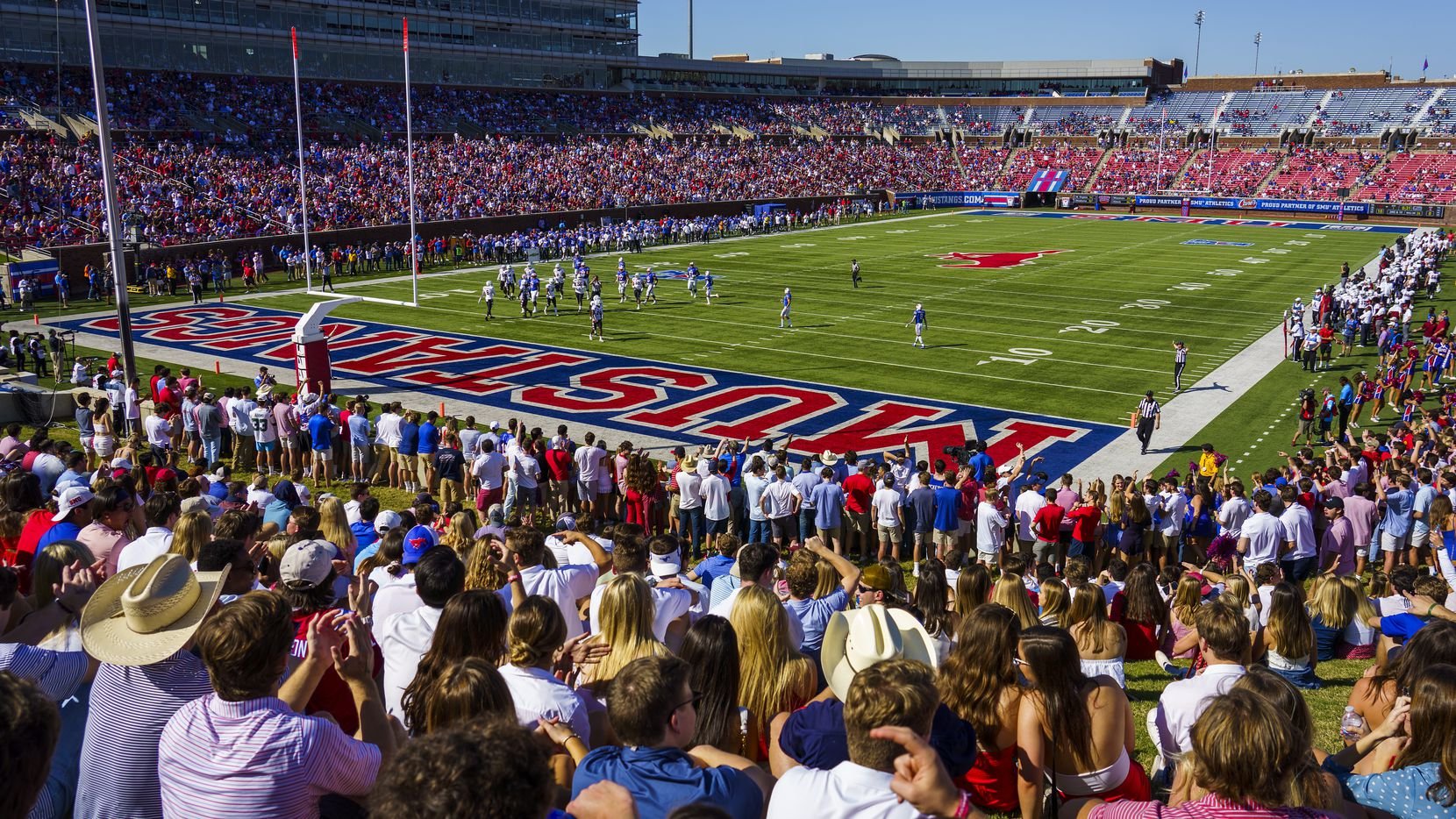 FILE - Fans watch during the first half of a football game between SMU and Temple at Ford Stadium on Saturday, Oct. 19, 2019, in Dallas.