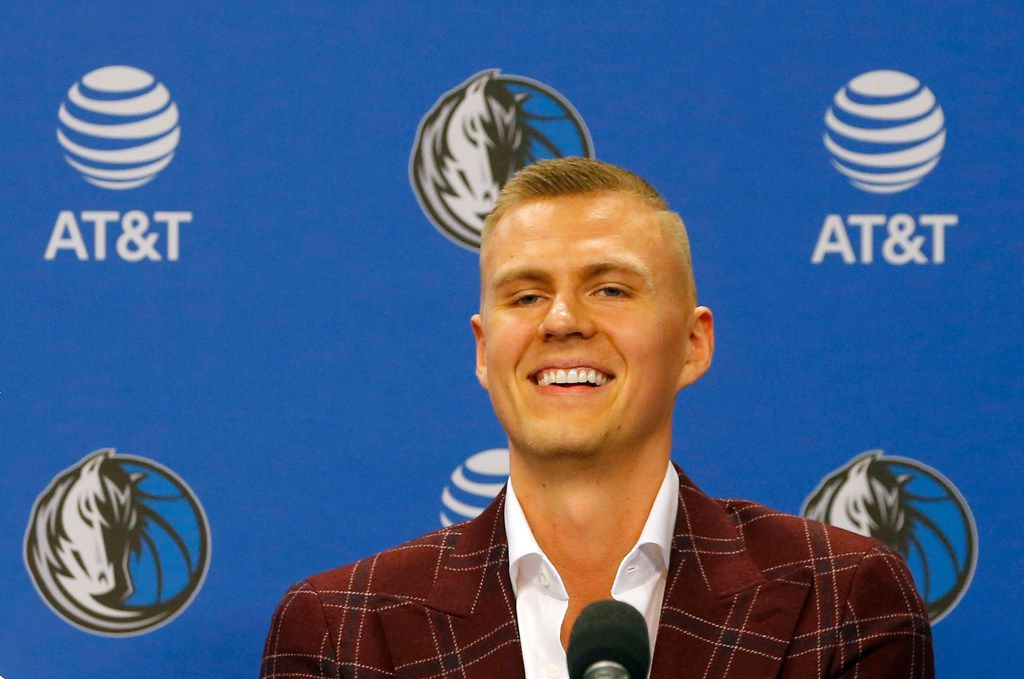 Kristaps Porzingis (6) laughs during his introductory Mavericks press conference at American Airlines Center in Dallas on Monday, Feb. 4, 2019. (Vernon Bryant/The Dallas Morning News)