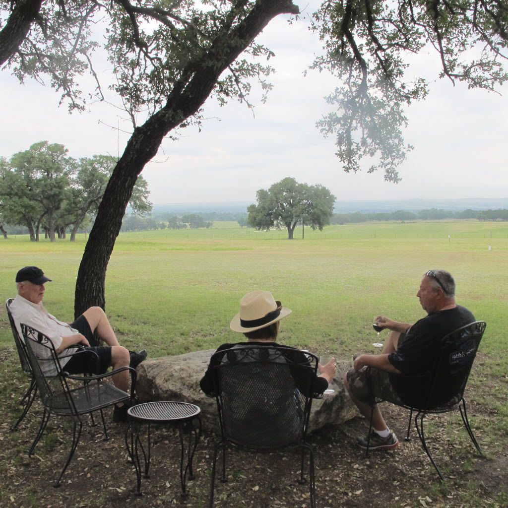 At Pedernales Cellars, guests enjoy wine with a view of the Pedernales River Valley in Stonewall, Texas