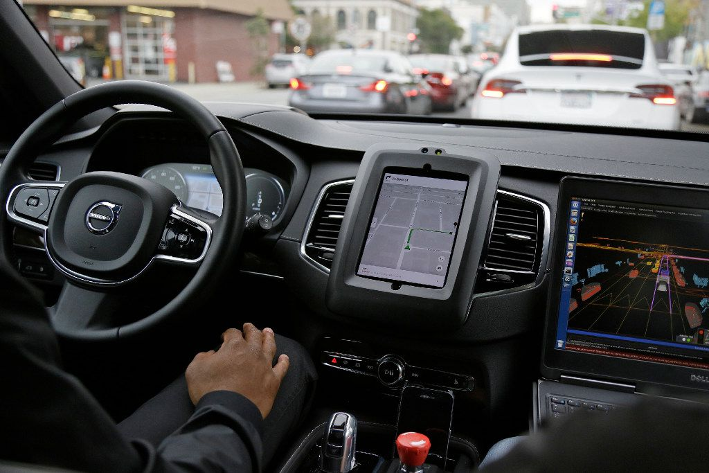 An Uber driverless car waits in traffic during a test drive in San Francisco in December 2016.
