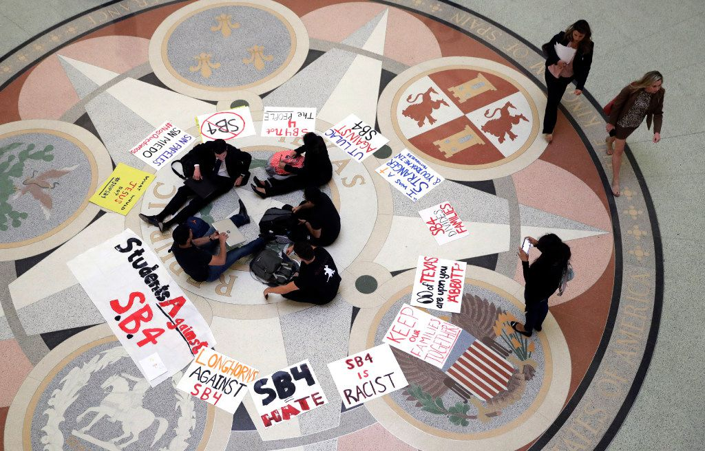 Students gathered in the rotunda at the Texas Capitol to protest Senate Bill 4 last week.